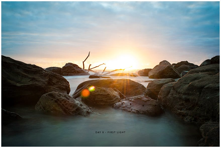 Stunning photos of sun rising over rocks in sea