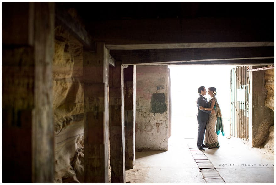 Bride and groom hugging in tunnel at Cockatoo Island