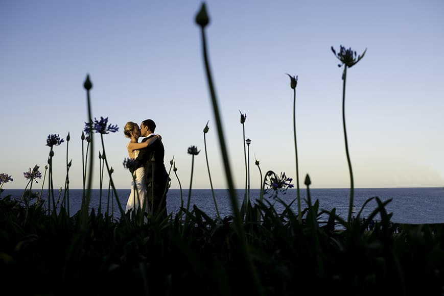 Bride and Groom amongst flowers in Gold Coast