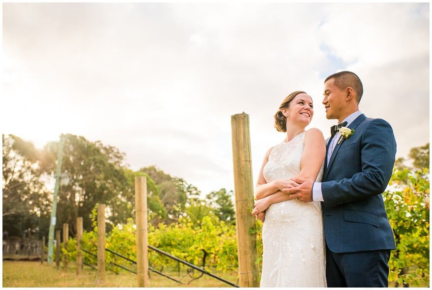 Bride and groom smiles while staring each others face