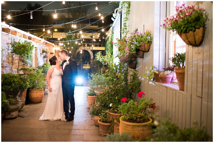 Bride and groom kissing at the garden area