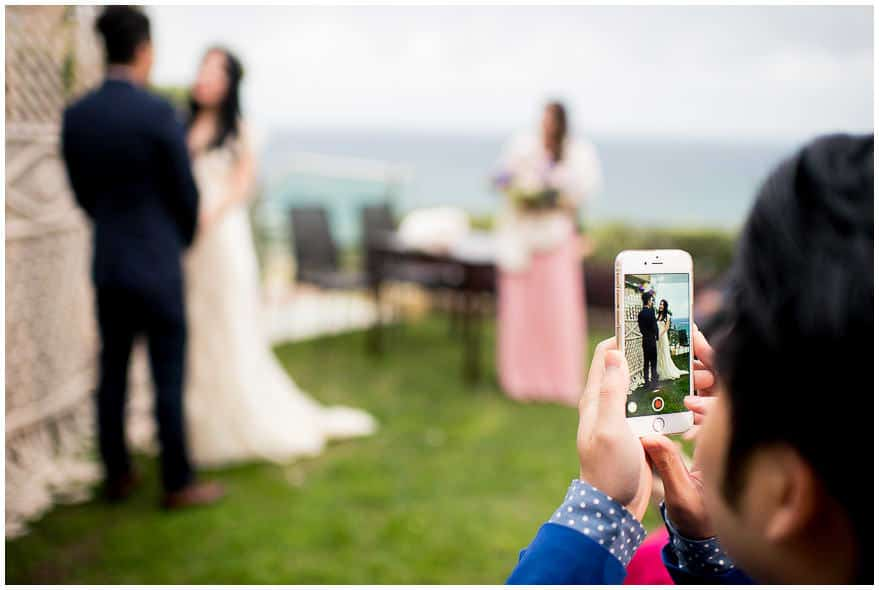 unplugged wedding | guest using a mobile phone