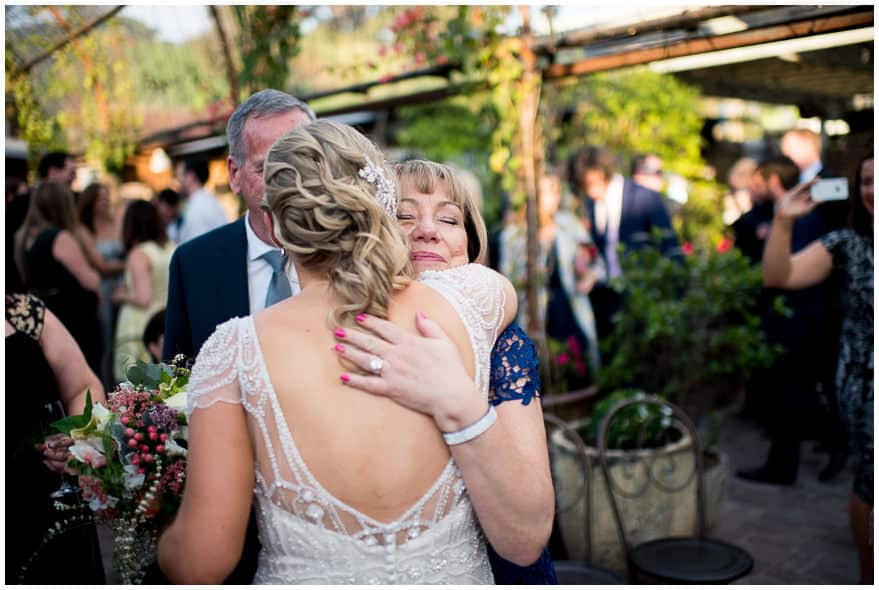 Wedding Family Photos - bride's mum hugs bride after the ceremony