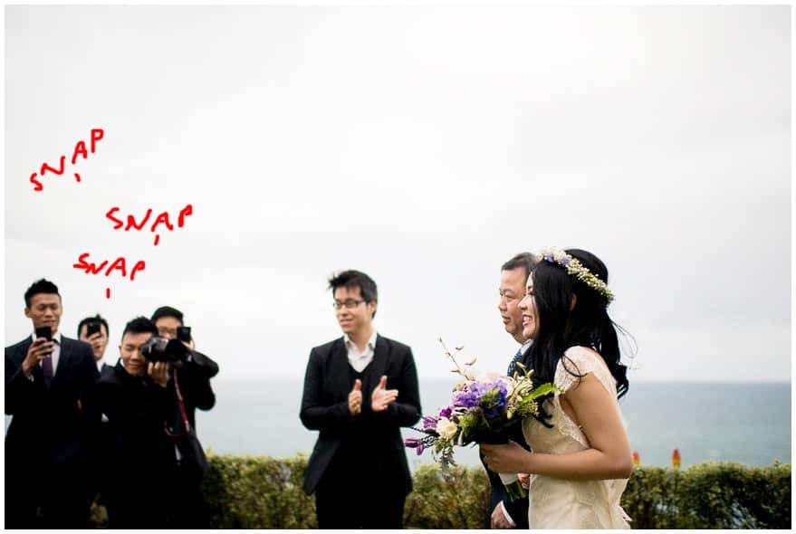 in favour of the unplugged wedding - photographers fight over the shot