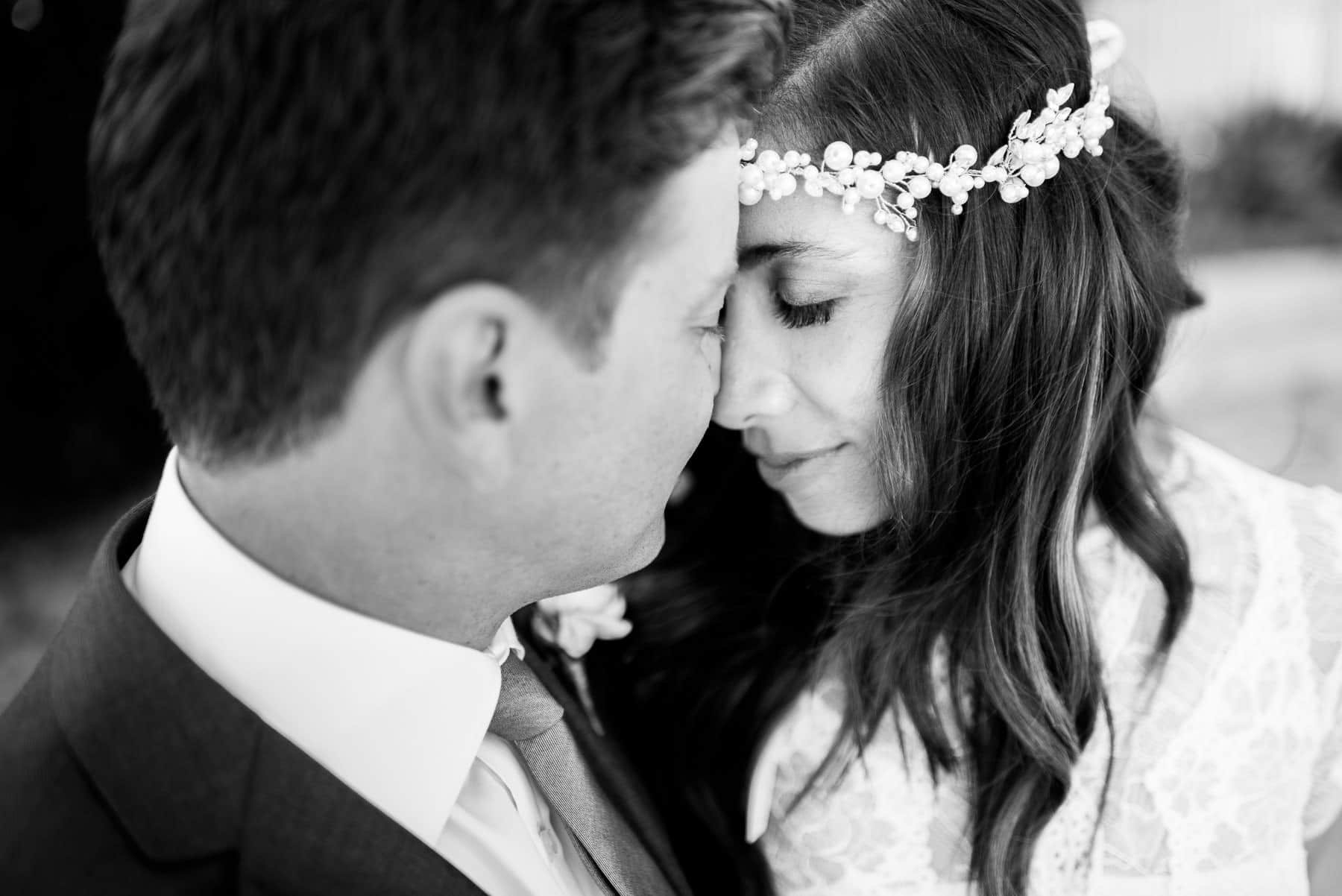 Intimate black and white photo of groom and bride during Whale Beach Wedding Photos