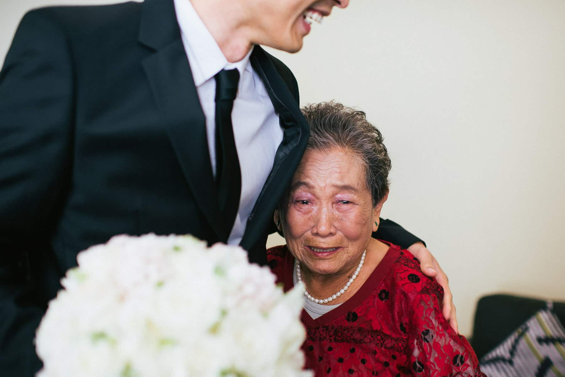 emotional grandma hugs groom