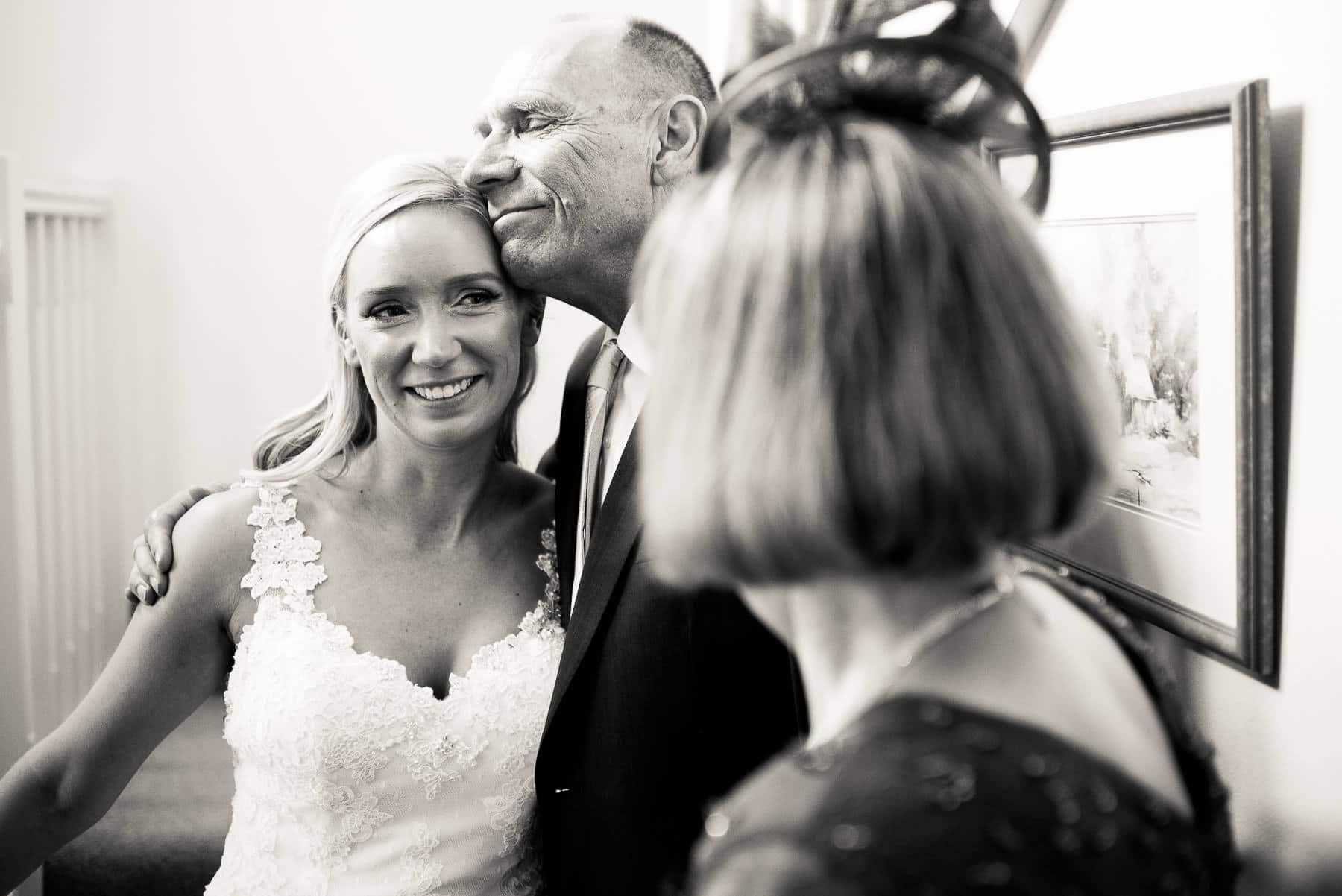 Natural Wedding Photography - Bride's father sees bride