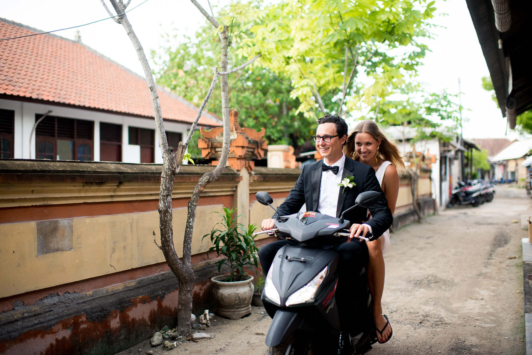 bride and groom on scooter at Bali destination wedding