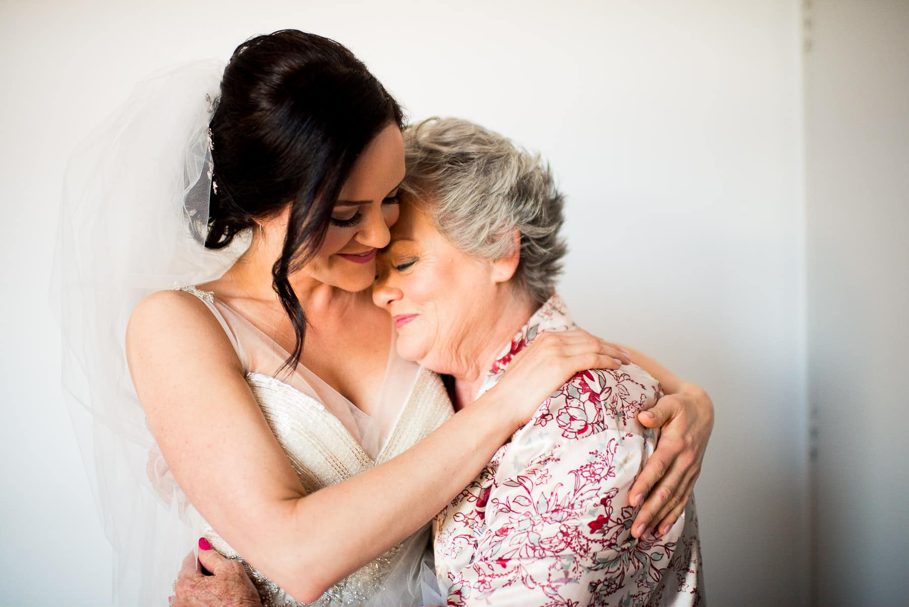 bride's mother hugs bride