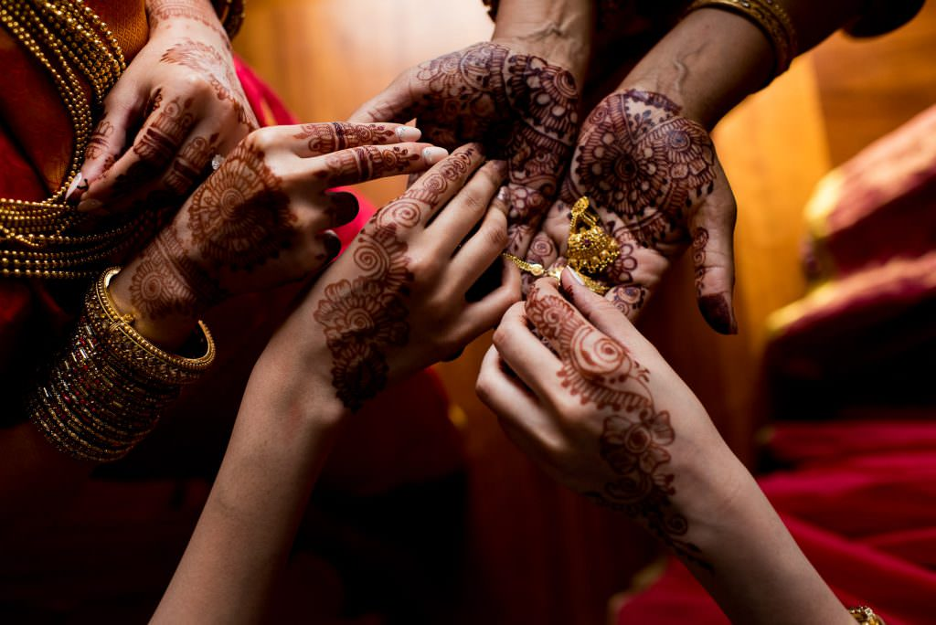 Beautiful henna on bridesmaids' hands at Indian wedding