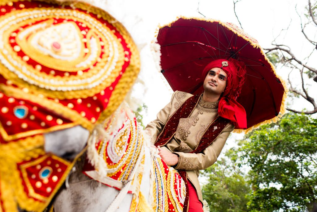 Indian wedding photography - groom on horse