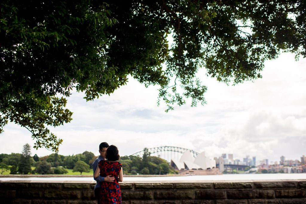 couple hugging in botanic gardens in Sydney during photography session