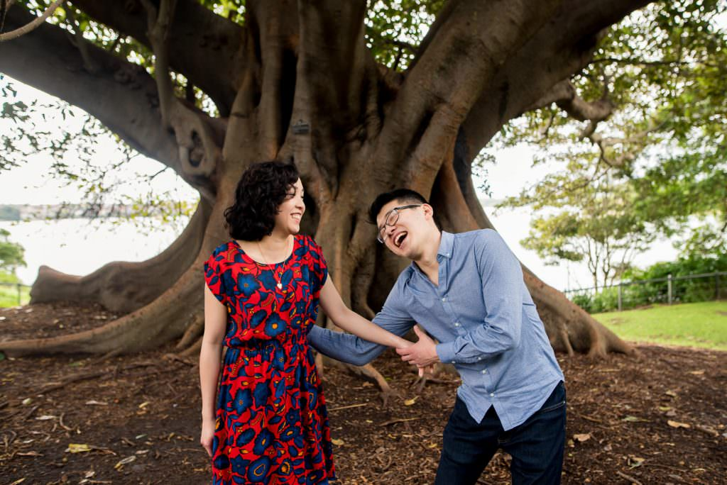 couple tickling each other during engagement photography session