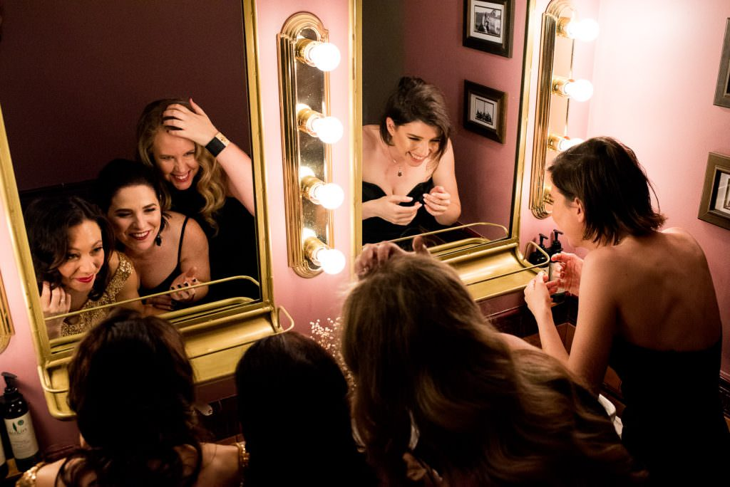 Kitty Hawk girls in makeup room