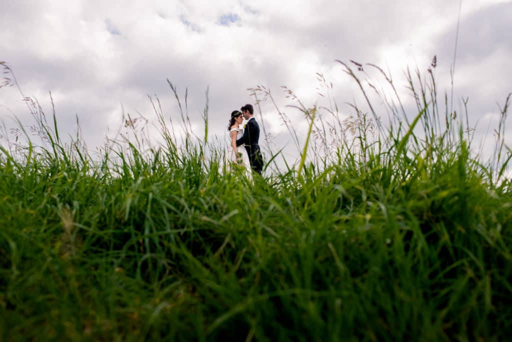 London wedding photography bride and groom in long grass