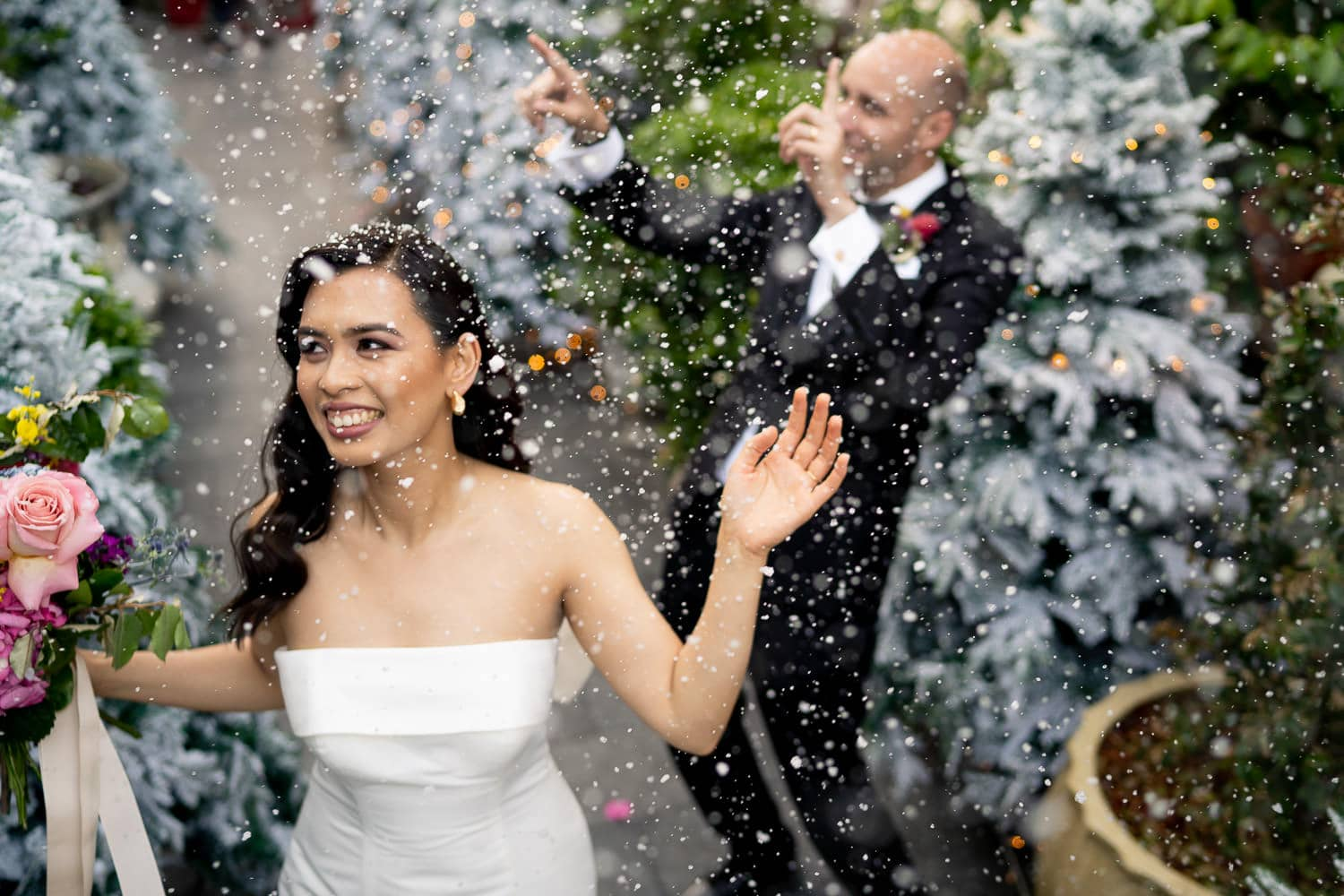 bride and groom dancing in snow at Grounds of Alexandria Atrium wedding